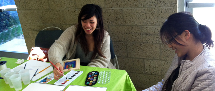 Students have fun at one of several crafts tables